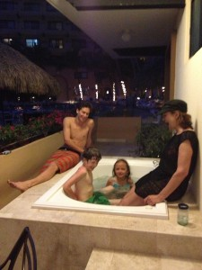 Family in outdoor bathtub on patio in Puerto Vallarta, Mexico