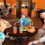 Laughing family hanging out at Aquaventuras Park Vallarta