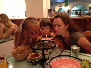 Mom and kids sharing a big virgin strawberry margarita