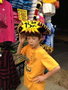 Boy models funny sombrero with price tag still on it