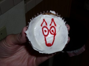 Easy dog cupcake with red icing