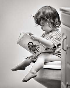 toddler reading on toilet