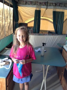 little girl cleaning tent trailer