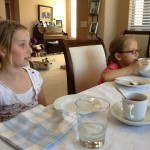 Little girls having tea party with Davidson's tea and Nature's Bakery fig bars