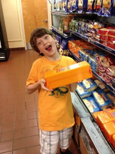 Boy with huge block of Tillamook cheese at factory