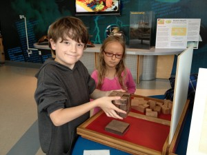 Kids playing with puzzles at Hatfield Marine Science Center in Newport.
