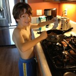 boy makes macaroni and cheese