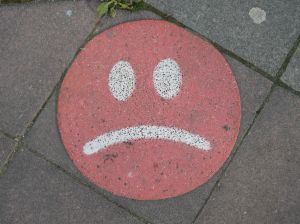 unhappy face on sidewalk