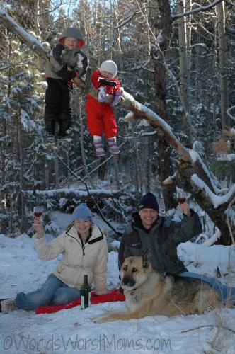 Picnic in the snow with the kids hanging in the trees -- our holiday card